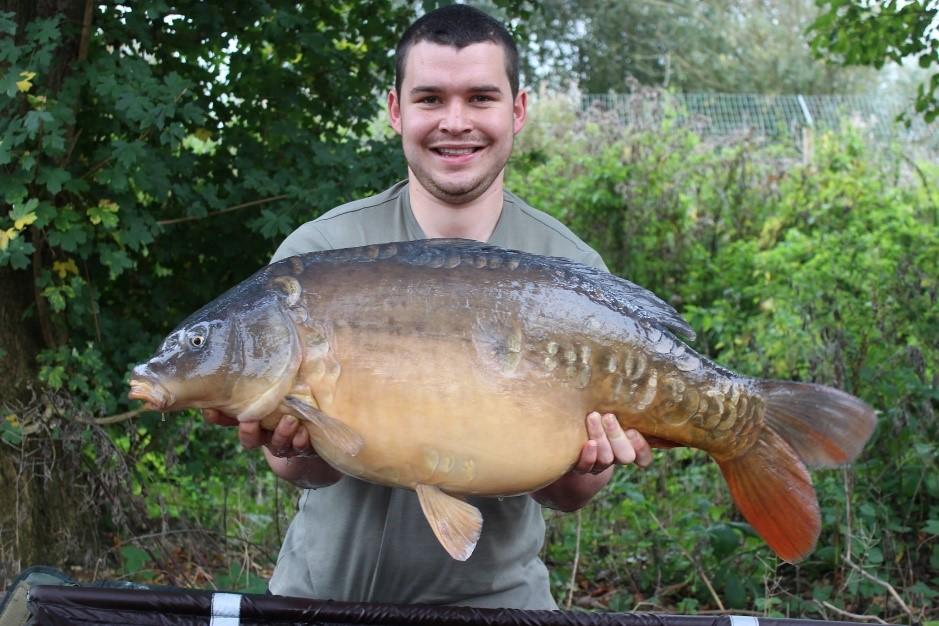 John Webster holding a big Carp fish.