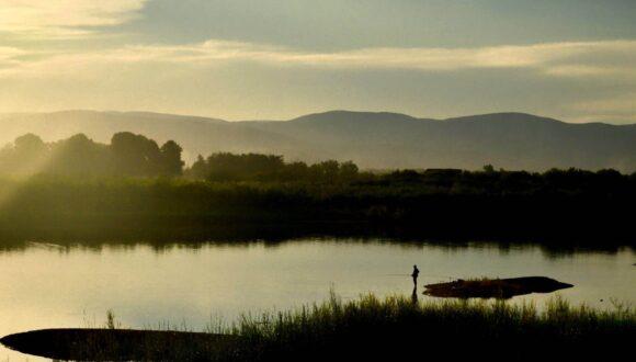 Lake with fisherman.