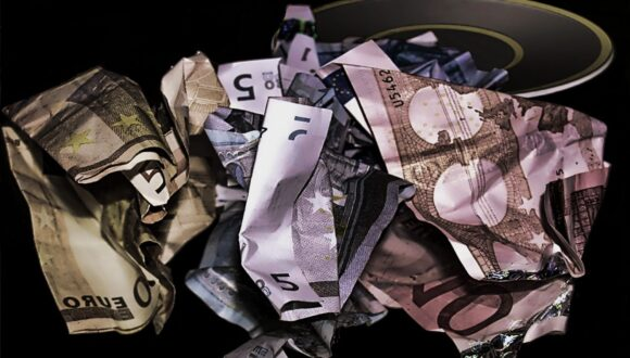 Variety of scrunched currency notes.