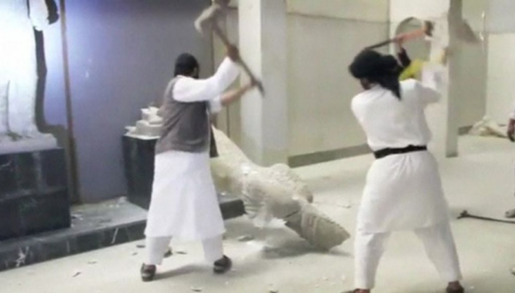 2 Masked people destroying artwork in the museum